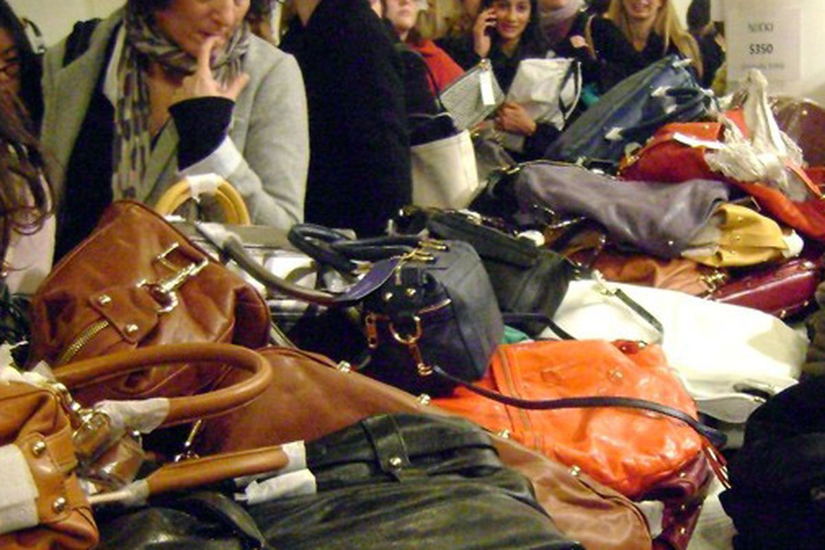 """Deep within the eye of the storm at Rebecca Minkoff <a href=""""http://racked.com/archives/2009/11/18/above_the_fray_a_sea_of_bags_and_buyers_at_rebecca_minkoff.php"""">sale</a>"""