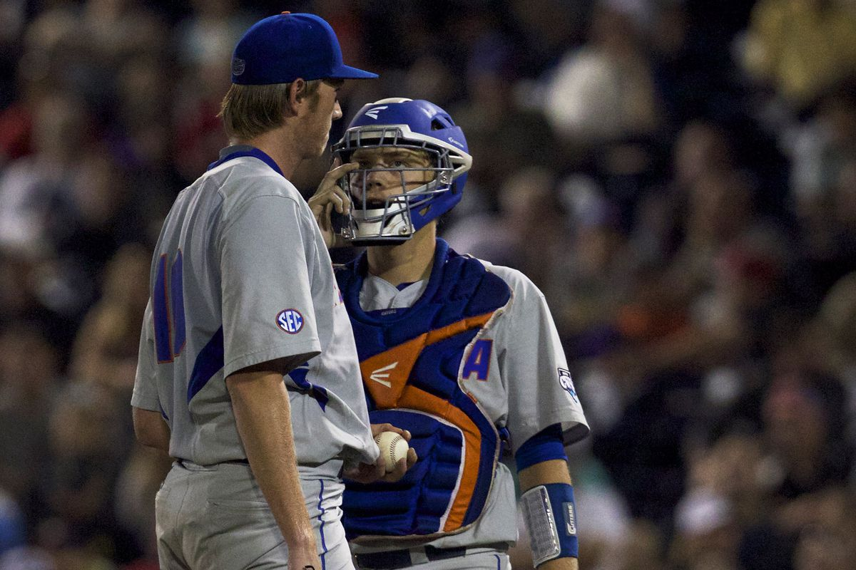 A.J. Puk and JJ Schwarz, probably discussing the advantages of having initials as their nicknames.