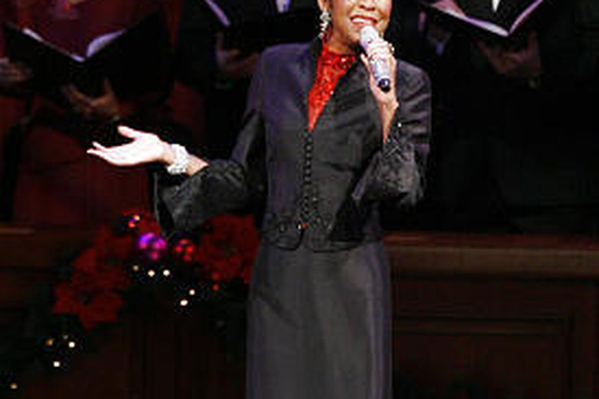 """Natalie Cole performs with the Mormon Tabernacle Choir during a dress rehearsal Thursday for the choir's annual Christmas concert, """"The Wondrous Gift of Christmas."""""""