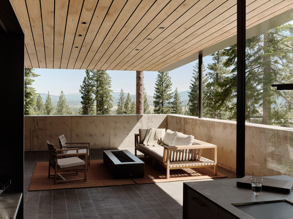Covered deck featuring fire pit.