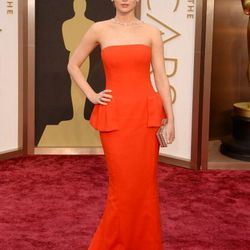 J.Law matching the carpet in a bright red Dior peplum gown.