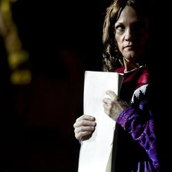 """Clutching the manuscript, Glynne Scholle plays the part of Lucy Harris, wife of Martin Harris at the performance of the Martin Harris Pageant: """"The Man Who Knew"""" in Clarkston, Utah on Thursday, Aug., 13, 2009."""