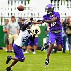 Jul 27, 2013; Mankato, MN, USA; Minnesota Vikings wide receiver Chris Summers (18) catches a pass over cornerback Jacob Lacey (26) during at training camp at Blakeslee Fields. Mandatory Credit: Bruce Kluckhohn-USA TODAY Sports