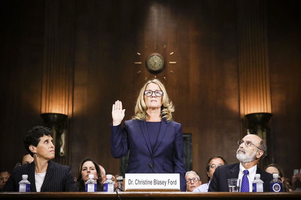 Christine Blasey Ford is sworn in before testifying the Senate Judiciary Committee with her attorneys Debra Katz (left) and Michael Bromwich (right) in the Dirksen Senate Office Building on Capitol Hill September 27, 2018.