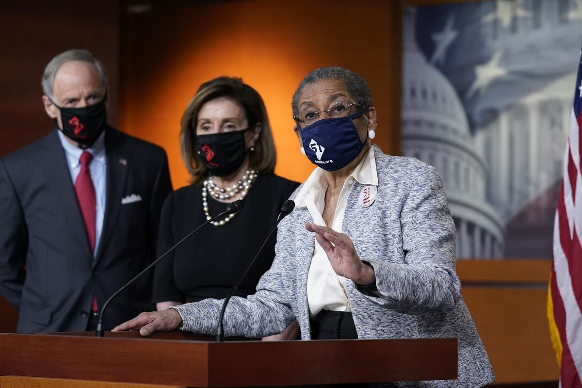 In this April 21, 2021, photo, Del. Eleanor Holmes-Norton, D-D.C., center, joined from left by Sen. Tom Carper, D-Del., and House Speaker Nancy Pelosi, D-Calif., speaks at a news conference ahead of the House vote on H.R. 51- the Washington, D.C. Admission Act, on Capitol Hill in Washington.