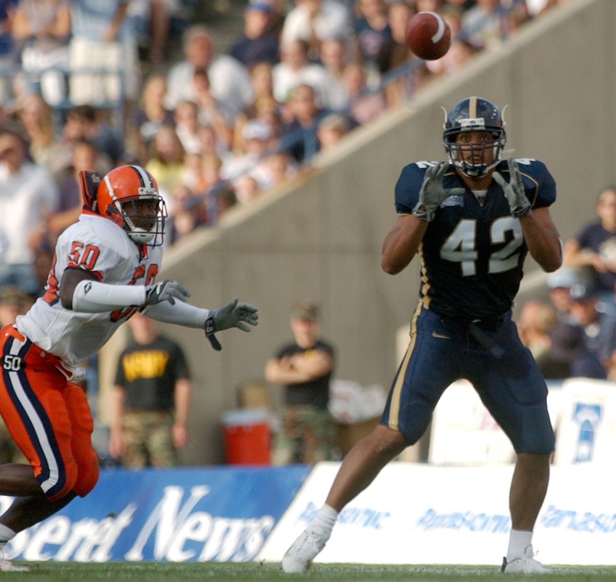 BYU's Gabriel Reid (42) waits for the ball as Syracuse's Jameel Dumas (50) comes in for the tackle at LaVell Edwards Stadium in Provo Thursday, August 29, 2002.