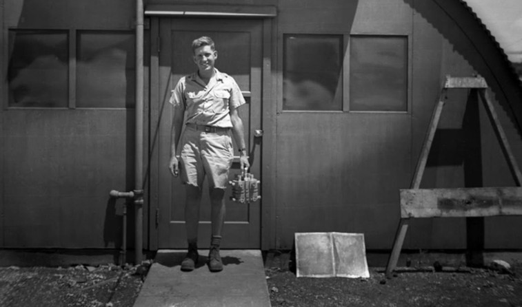 Physicist Harold Agnew holding the plutonium core of the Fat Man bomb dropped on Nagasaki Japan in 1945.