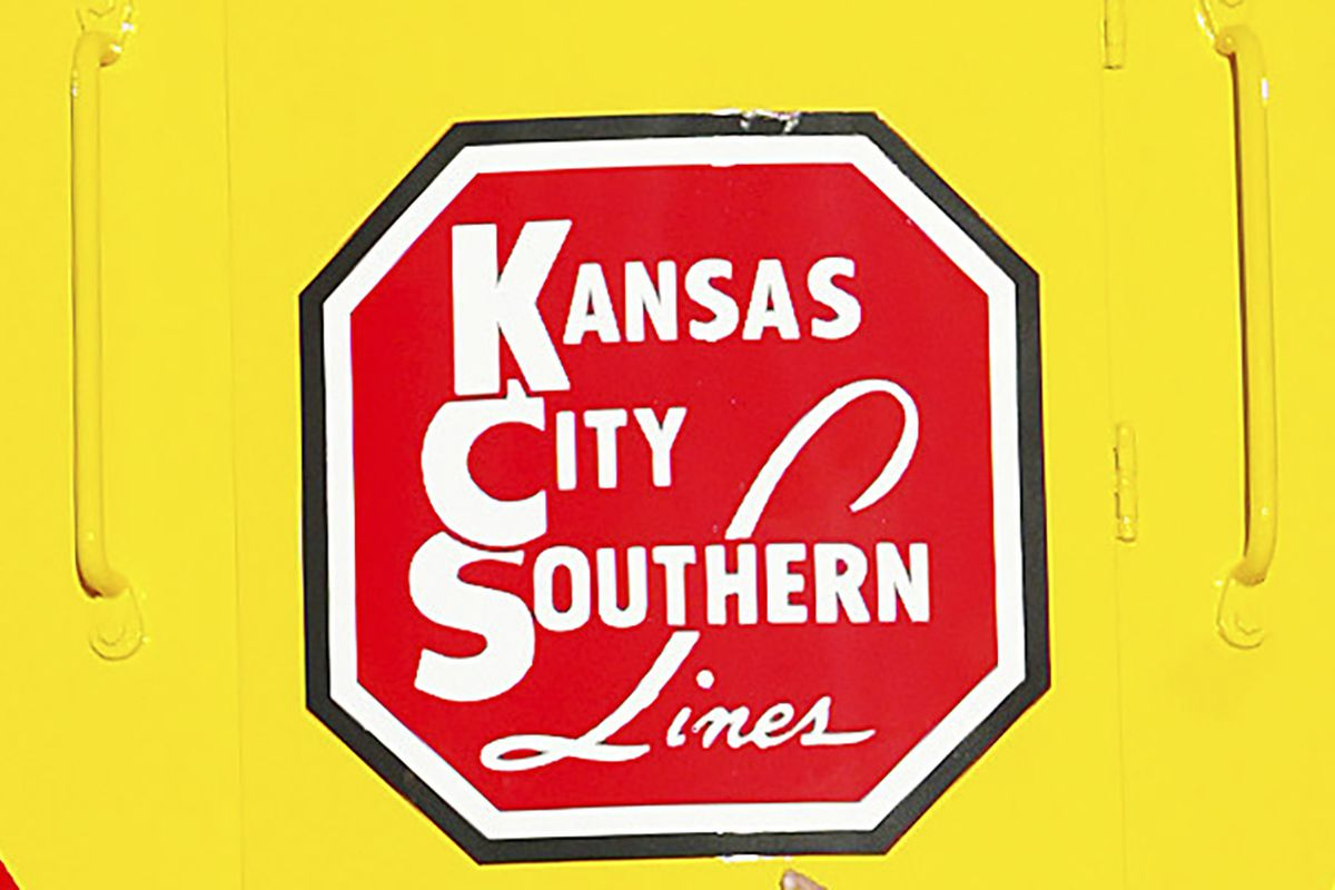 In this Nov. 5, 2004 file photo, the logo of Kansas City Southern is down on a restored 1954 Kansas City Southern passenger locomotive at Union Station in Kansas City, Mo. A bidding war is breaking out for Kansas City Southern, with Canadian National Railway making a $33.7 billion cash-and-stock offer for the railway. The bid trumps a $25 billion cash-and-stock proposal made by Canadian Pacific last month.
