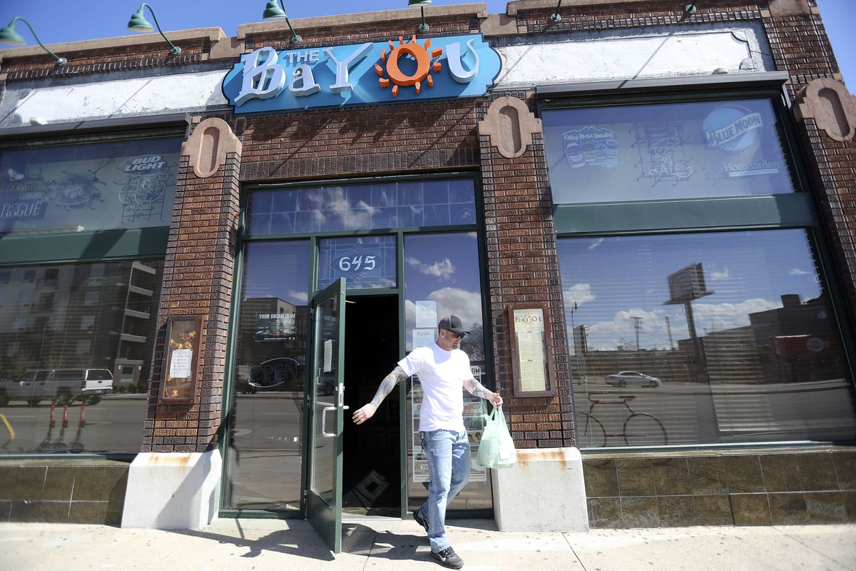 Dennis Malcom picks up a to-go order at The Bayou in Salt Lake City on Tuesday, March 17, 2020. A Salt Lake County health order prohibits dine-in options for all restaurants, taverns, bars, clubs and entertainment venues in an effort to slow the spread of COVID-19.