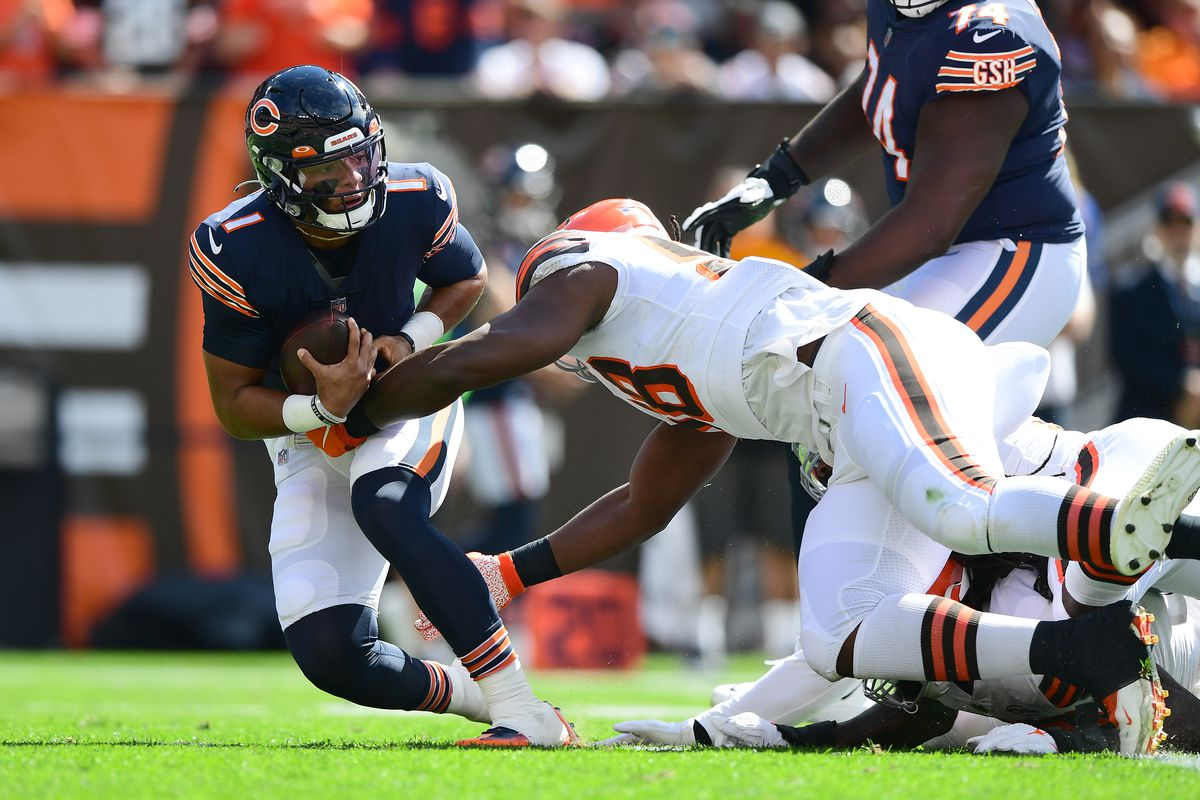Justin Fields of the Chicago Bears is sacked during the first quarter in the game against the Cleveland Browns at FirstEnergy Stadium on September 26, 2021 in Cleveland, Ohio.