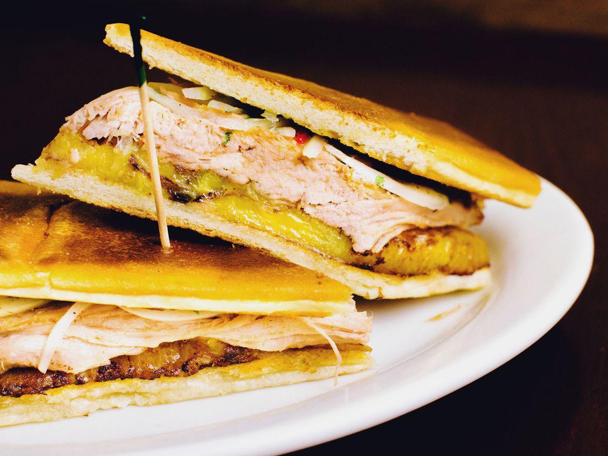 A Cuban sandwich on a white plate