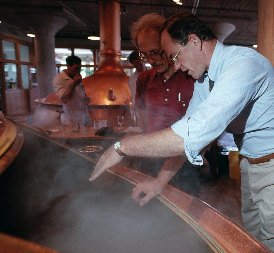 Professor Miguel Civil (left) and Fritz Maytag (right), then-chief of Anchor Brewing, huddled to create a beer based on the University of Chicago professor's translation of ancient Sumerian drinking songs. | Anchor Brewing