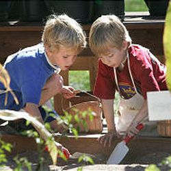 Jackson Collins, left, and Liam Davis plant seeds at an FFA exhibit at the State Fair. Fairgoers learned about other farming chores as well.