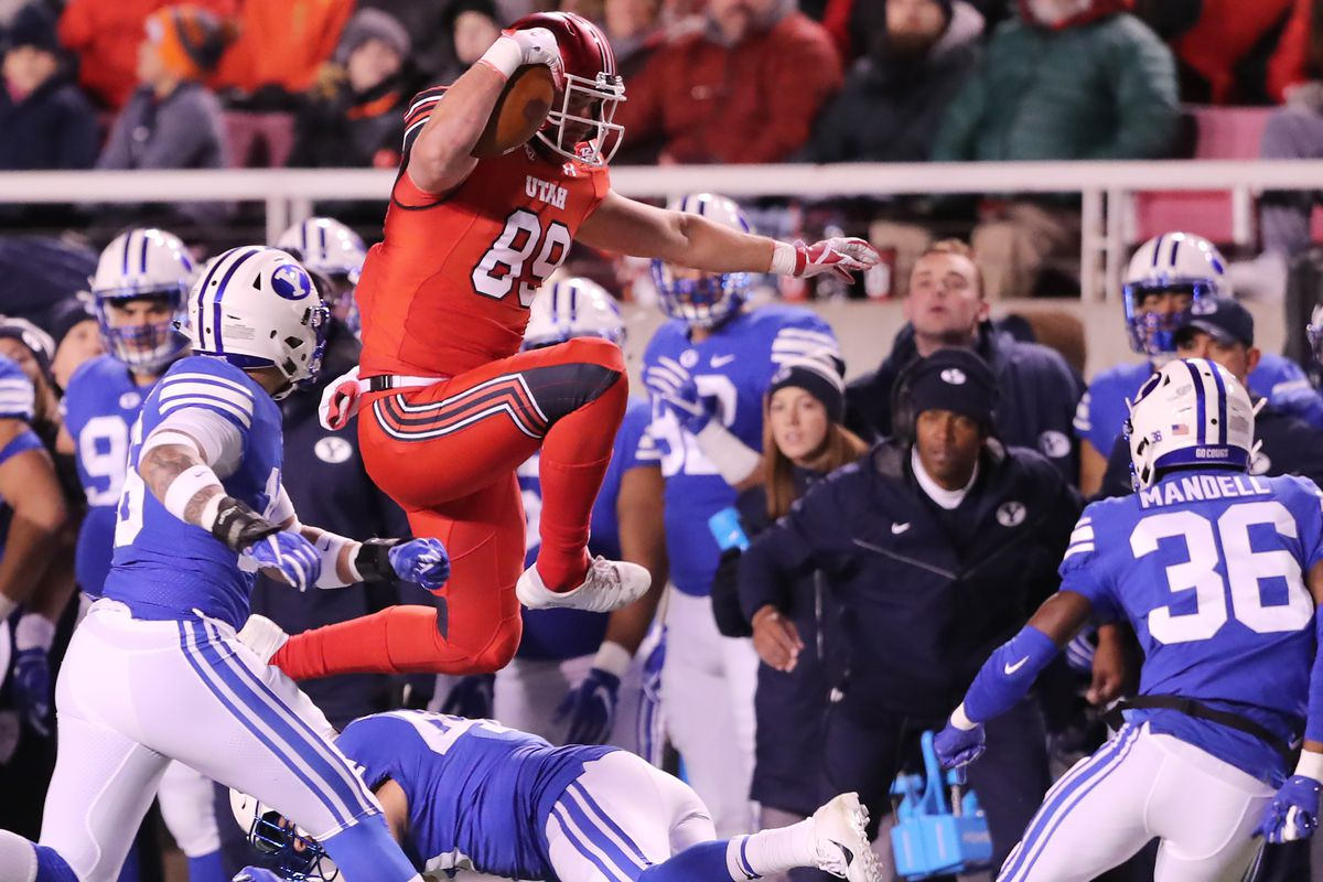 Utah tight end Cole Fotheringham jumps over a defender as BYU and Utah play at Rice-Eccles Stadium in Salt Lake City on Saturday, Nov. 24, 2018.