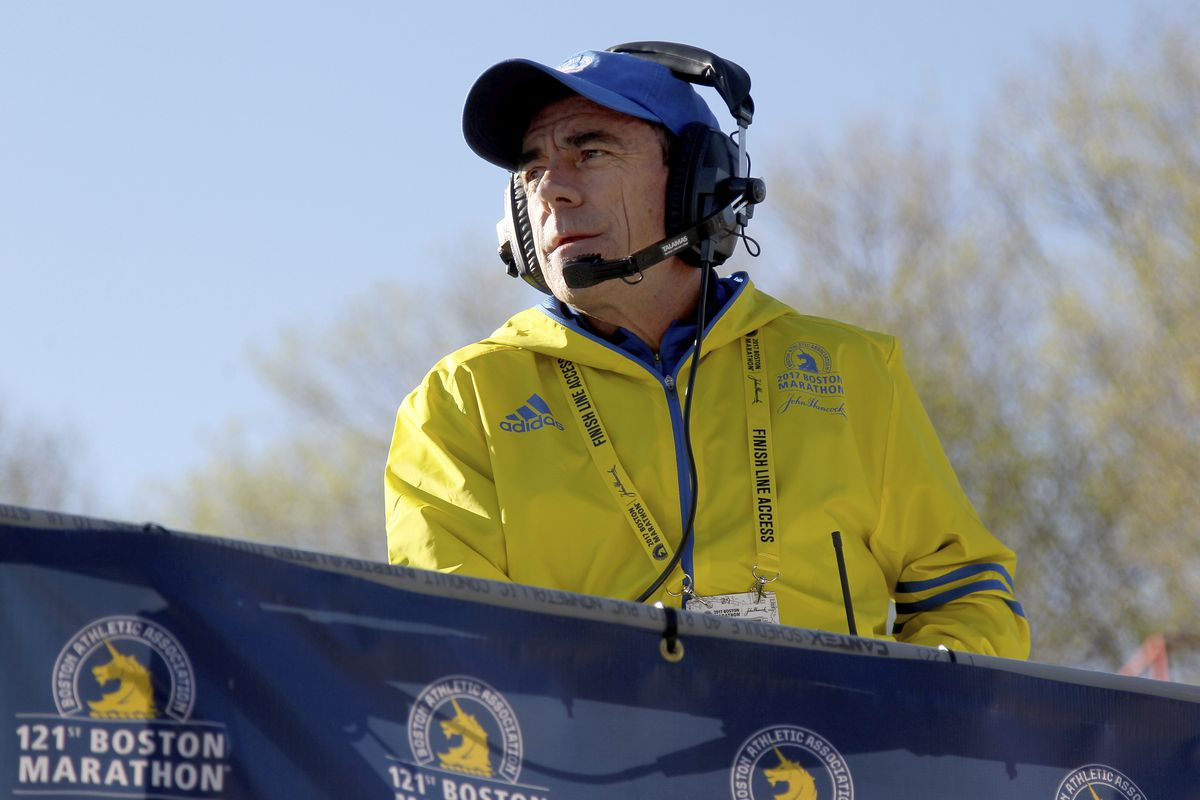In this April 17, 2017, file photo, Race Director Dave McGillivray looks on from the platform at the start of the 2017 Boston Marathon in Hopkinton, Mass.