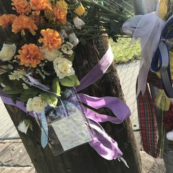A memorial marks the intersection where Jeremy Hardman, 47, died June 7, 2017, after police say he got into a confrontation with Aaron Hosman, 40, about Hosman's treatment of a dog, leading Hosman to run over Hardman with his car. Hosman has been arrested for investigation of murder.