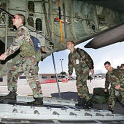 Members of the Utah National Guard enter a C-130 transport plane Sunday on a mission to help after Hurricane Rita.