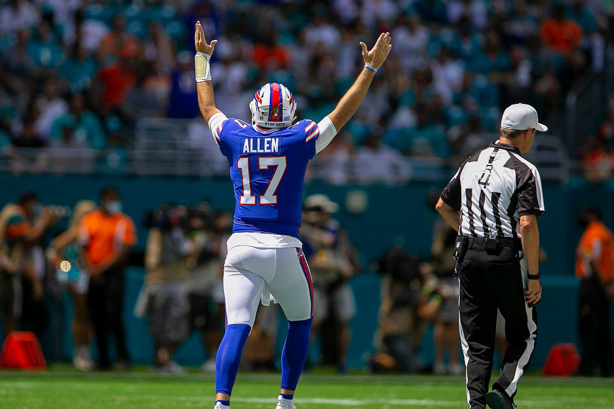 Buffalo Bills Buffalo Bills quarterback Josh Allen (17), cheers the first touchdown agains the Dolphins during NFL game at Hard Rock Stadium Sunday in Miami Gardens.