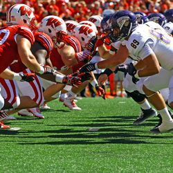 The Badgers defensive line collides with the offensive line of Western Illinois