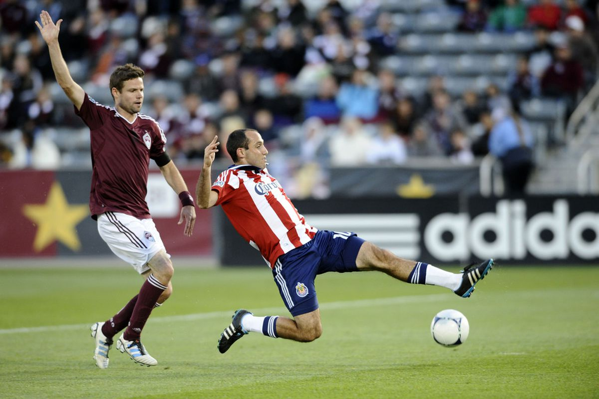 April 28, 2012; Commerce City, CO, USA; Colorado Rapids defender Drew Moor (3) lets Chivas USA midfielder Nick LaBrocca (10) get past him during the first half at Dick's Sporting Goods Park. Mandatory Credit: Ron Chenoy-US PRESSWIRE