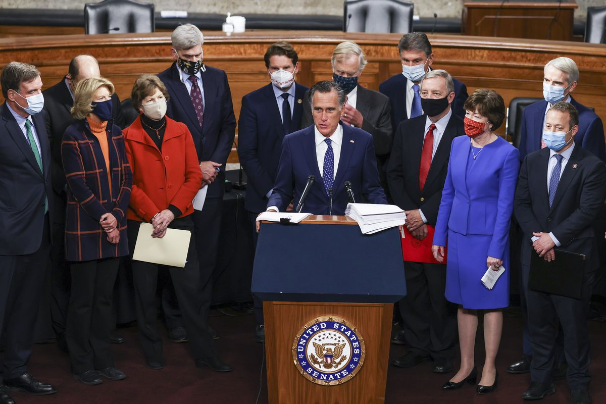 Sen. Mitt Romney (R-UT) speaks alongside a bipartisan group of Democrat and Republican members of Congress as they announce a proposal for a Covid-19 relief bill on Capitol Hill on December 14, 2020 in Washington, DC. Lawmakers from both chambers released a $908 billion package Monday, split into two bills. (Photo by Tasos Katopodis/Getty Images) ORG XMIT: 775600675