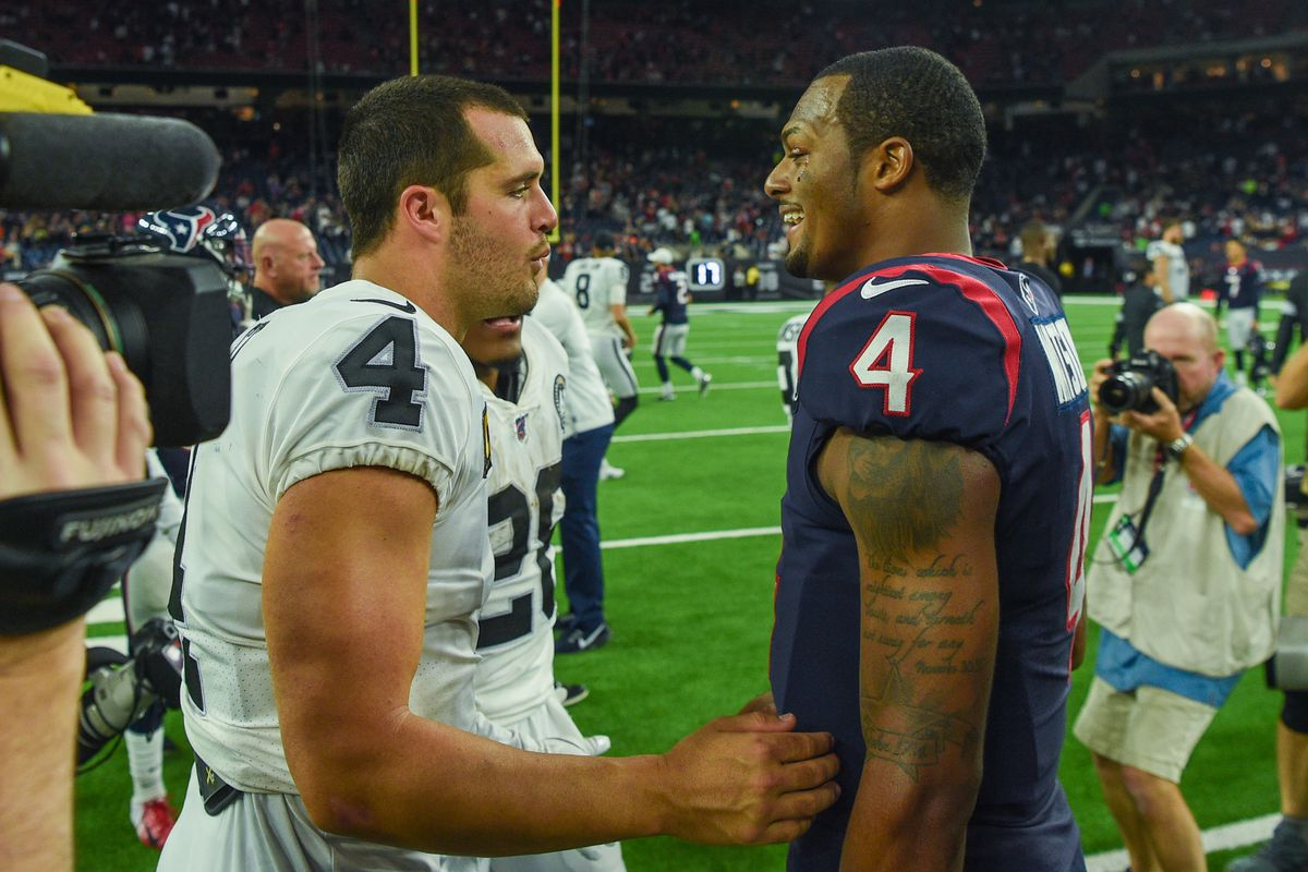 Oakland Raiders quarterback Derek Carr (4) and Houston Texans quarterback Deshaun Watson (4) chat following the football game between the Oakland Raiders and Houston Texans at NRG Stadium on October 27, 2019 in Houston, TX.