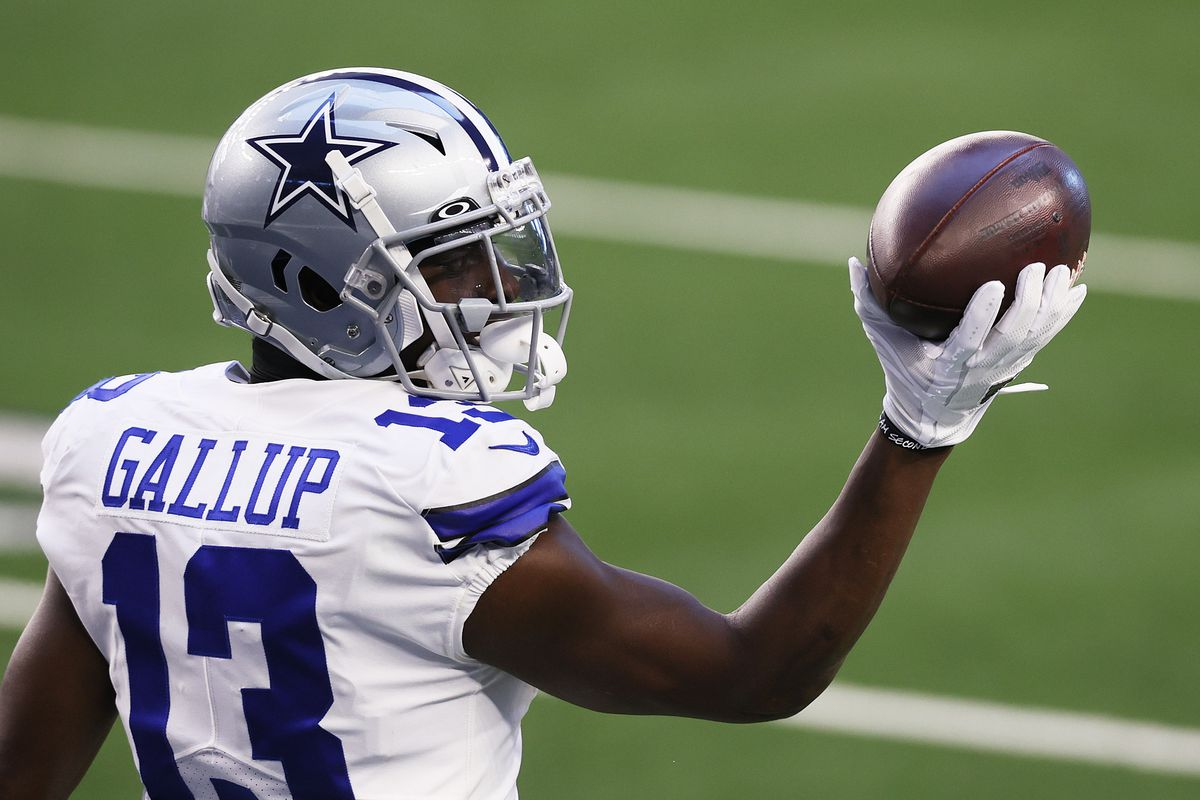 Wide receiver Michael Gallup #13 of the Dallas Cowboys celebrates a touchdown against the San Francisco 49ers during the first quarter at AT&T Stadium on December 20, 2020 in Arlington, Texas.