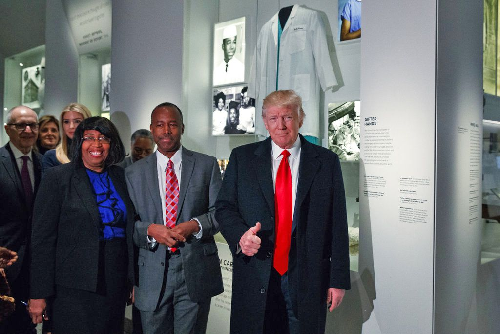 President Donald Trump tours the National Museum of African American History and Culture last year with Dr. Ben Carson and Carson's wife, Candy Carson.   Associated Press File Photo