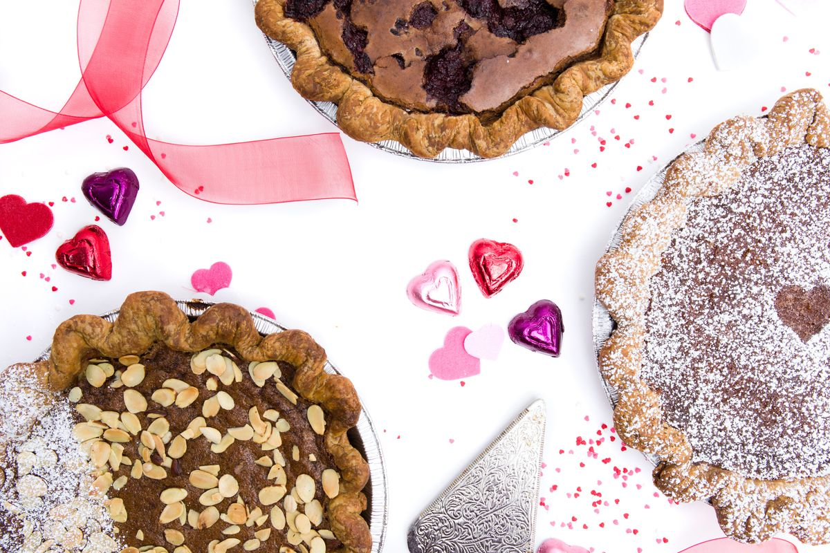 Three pies with chocolate hearts between them