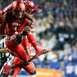 Utah Utes defensive back Boobie Hobbs (1) celebrates after intercepting a Brigham Young Cougars pass at LaVell Edwards Stadium in Provo on Saturday, Sept. 9, 2017.