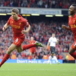Liverpool's Steven Gerrard, left, celebrates scoring against Manchester United during their English Premier League soccer match at Anfield in Liverpool, England, Sunday Sept. 23, 2012.