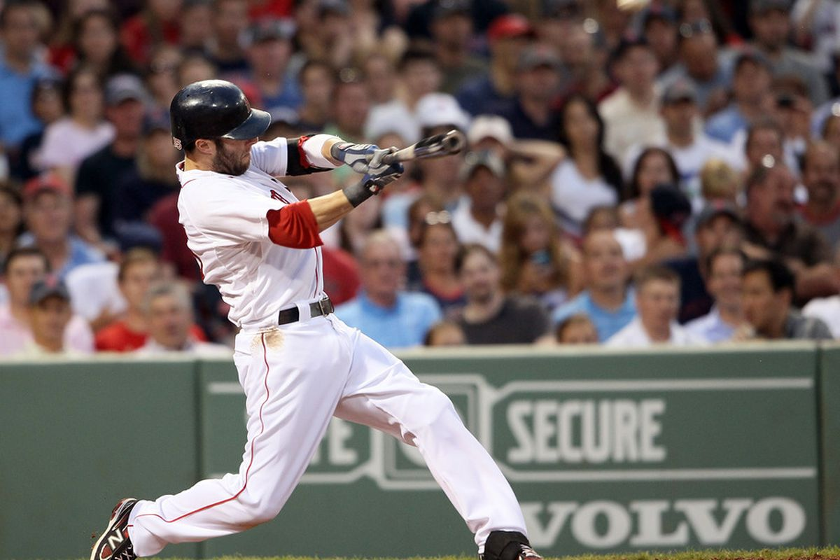 BOSTON, MA - JULY 07:  Dustin Pedroia #15 of the Boston Red Sox hits a three run homer against the Baltimore Orioles in the third inning on July 7, 2011 at Fenway Park in Boston, Massachusetts.  (Photo by Elsa/Getty Images)