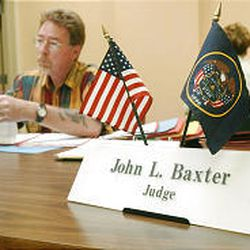 Judge John Baxter listens to a case at the Weigand Resource Center. The court for homeless has been operating for the past year.