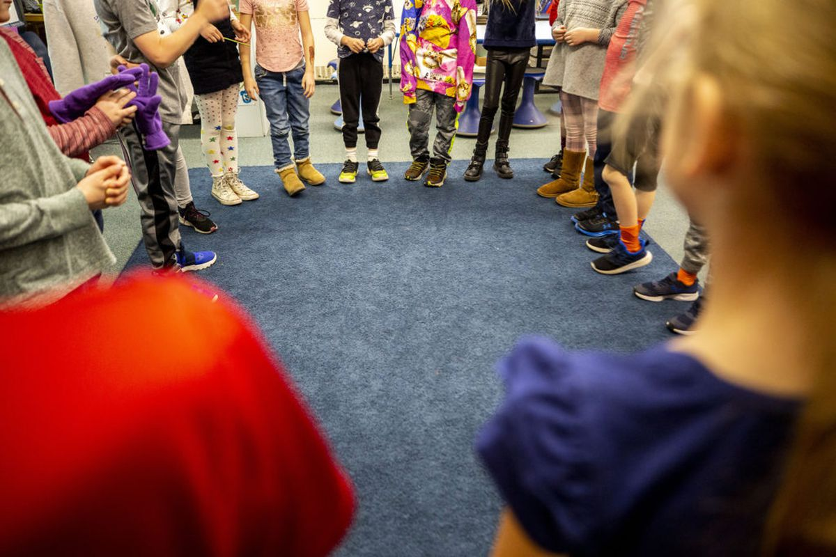 Second graders stand in a circle for a game in Kari Notton's class at Carson Elementary, March 13, 2020.