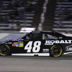 Jimmie Johnson (48) takes Turn 4 during the NASCAR Sprint Cup Series auto race at Texas Motor Speedway Saturday, April 14, 2012, in Fort Worth, Texas.