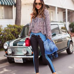 """Aimee of <a href=""""http://www.songofstyle.com""""target=""""_blank""""> Song of Style</a> is wearing a <a href=""""http://www.7forallmankind.com/Fashion_Pieced_Skinny_in_Black_Jeather_and_Denim/pd/np/1215/p/8609.html""""target=""""_blank"""">7 For All Mankind</a> jacket and j"""
