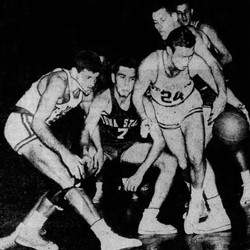 Dudley Ruisch of Iowa State battles for possession of the ball with Tom Tolan (left) and Don Noonan (24) of St. John's Tuesday night (Dec. 21, 1948) in Madison Square Garden. The Cyclones lost, 71-47.