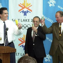 SLOC President Mitt Romney, left, raises a glass in a toast to unity with area leaders during a news conference at SLOC headquarters Friday, March 16, 2001.