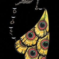 """""""The Peacock Half Bib Necklace ($45) has also been around for a while, and it's most popular in <a href=""""http://birdqueendesigns.com/artwork/1673924_Green_Peacock_Half_Bib_Necklace.html"""">green</a>. The <a href=""""http://birdqueendesigns.com/artwork/1673927_"""