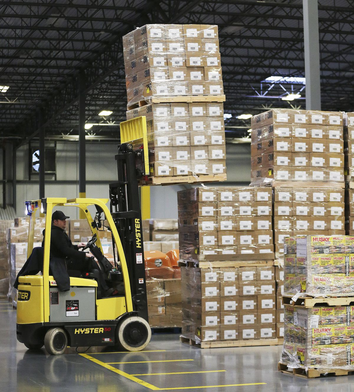 Bishop's Central Storehouse workers load supplies as The Church of Jesus Christ of Latter-day Saints sends aid to China in Salt Lake City on Wednesday, Jan. 29, 2020. Respirator masks, protective goggles and protective suits were sent.
