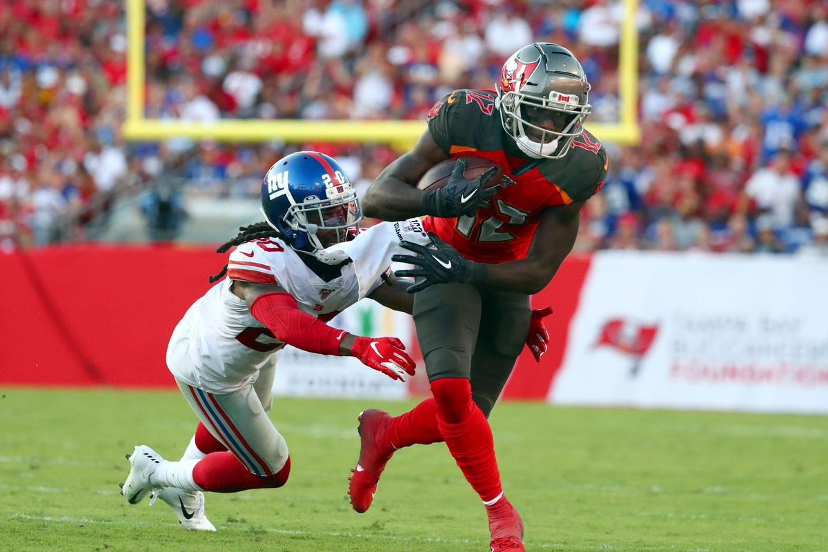 Tampa Bay Buccaneers wide receiver Chris Godwin runs with the ball against New York Giants cornerback Janoris Jenkins during the second half at Raymond James Stadium.