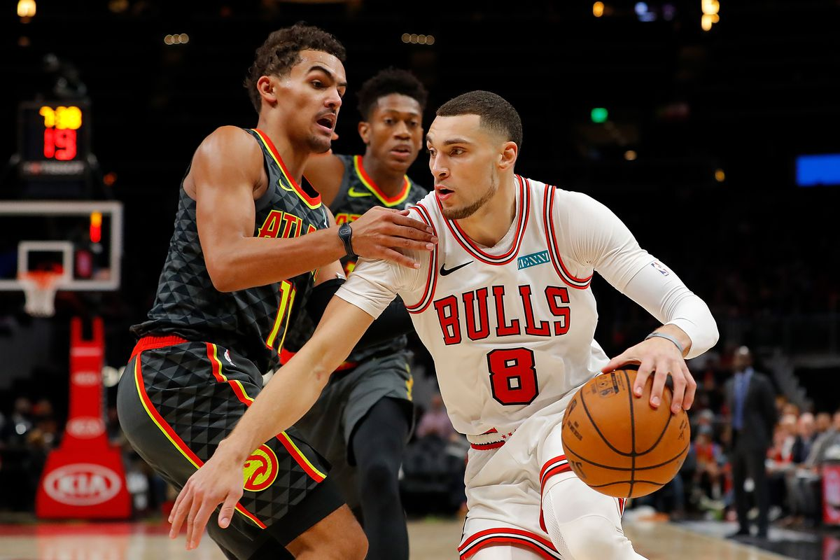 Zach LaVine of the Chicago Bulls drives against Trae Young of the Atlanta Hawks in the second half at State Farm Arena on November 06, 2019 in Atlanta, Georgia.