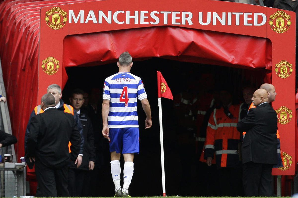 Queens Park Rangers' captain Shaun Derry makes his way from the pitch after being sent off during his team's English Premier League soccer match against Manchester United at Old Trafford Stadium, Manchester, England, Sunday, April 8, 2012.