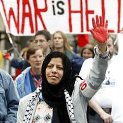 A woman in Berlin holds up her sign of protest against U.S. troops in Iraq.