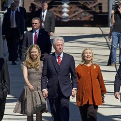 Former President Bill Clinton along with his wife and U.S. Secretary of State Hillary Rodham Clinton, right, and daughter Chelsea cross a new pedestrian bridge in Little Rock, Ark. Friday Sept. 30, 2011. Former president Clinton was in town to dedicate the bridge located adjacent to his presidential library.