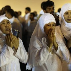 Muslim pilgrims pray near the holy city of Mecca, Saudi Arabia, Thursday, Oct. 25, 2012. Saudi authorities say around 3.4 million pilgrims — some 1.7 million of them from abroad — have arrived in the holy cities of Mecca and Medina for this year's pilgrimage. (AP Photo/Hassan Ammar)