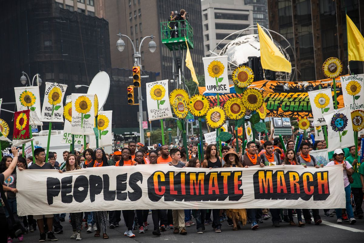 People march down Sixth Avenue during the People's Climate March on September 21, 2014 in New York City.