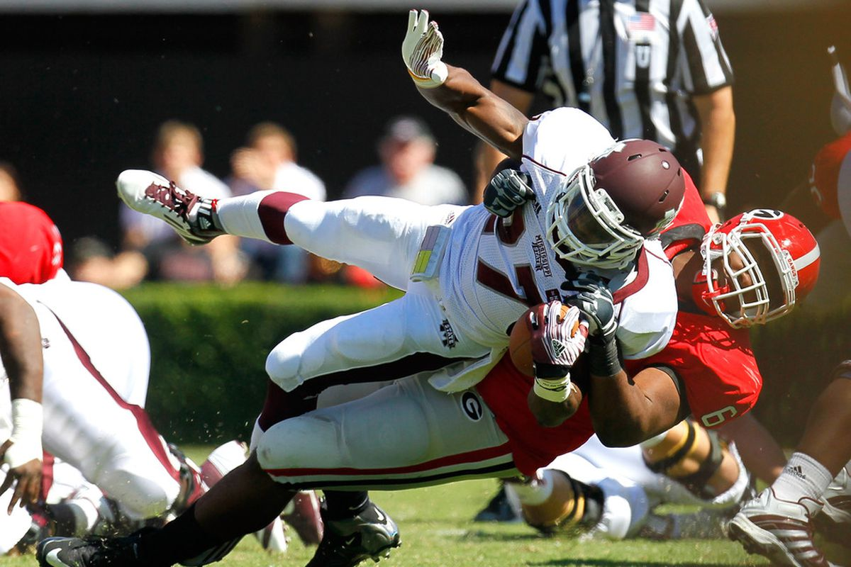 ATHENS, GA - OCTOBER 01:  Jonathan Jenkins #6 of the Georgia Bulldogs picks up and tackles LaDarius Perkins #27 of the Mississippi State Bulldogs at Sanford Stadium on October 1, 2011 in Athens, Georgia.  (Photo by Kevin C. Cox/Getty Images)