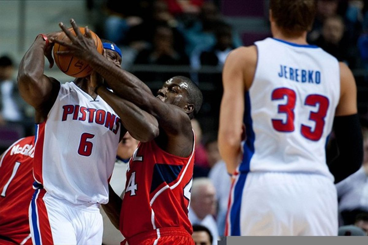 Mar 9, 2012; Auburn Hills, MI, USA; Atlanta Hawks forward Ivan Johnson (center) attempts to steal the ball from Detroit Pistons center Ben Wallace (6)during the first quarter at The Palace. Mandatory Credit: Tim Fuller-US PRESSWIRE