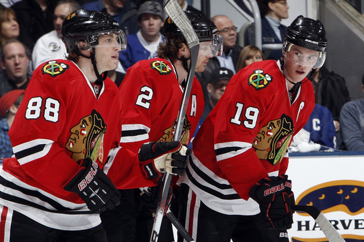 Patrick Kane, Duncan Keith and Jonathan Toews of the Chicago Blackhawks celebrate Jonathan Toews' goal during game action against the Toronto Maple Leafs at the Air Canada Centre in Toronto, Ontario, Canada. (Photo by Abelimages/Getty Images)